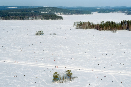 Ice-fishing enthusiasts spread out on the ice like ants during the Lake Kallavesi Finnish Championships.