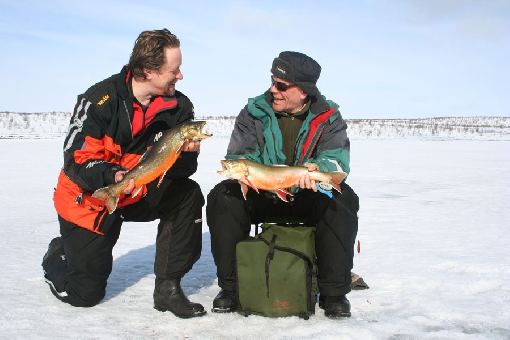 Ice-fishing for arctic char on a Kaldoaivi wilderness lake in Utsjoki.